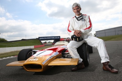 Damon Hill supports Vintage Dress Friday at the 2014 British Grand Prix in 60s clothing alongside his father Graham Hill s iconic 1969 Lotus 49B